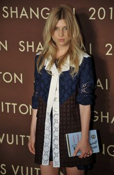 new concept 9b290 372ea Clémence Poésy at the Louis Vuitton store opening in Shanghai with a  Rimbaud book-clutch by Olympia Le-Tan.