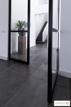 Inside doors with an unprecedented appearance. Inside steel and glass doors that enrich the home. Inside doors as a result of creativity, Dutch crafts Foyer Flooring, Grey Flooring, Grey Floor Tiles, Home Panel, Escalier Design, Inside Doors, Home Decor Furniture, Home Remodeling, New Homes