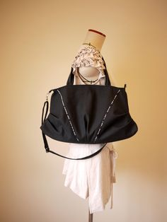 This black bag are so style. Easy to mix with the clothes.   Croissants  Tote & Cross Body Vegan Bag in Black Canvas by solaWu, $72.82