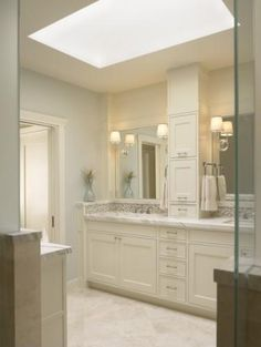 Bathroom Cabinets. like the tower in between the mirrors