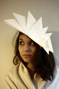 Origami headgear by Agathe Montenegro - reminds me of the Sydney Opera House
