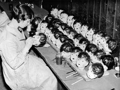 Take a peek at the captivatingly creepy inner-workings of doll factories from yesteryear.