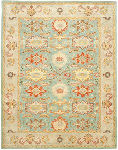 Turquoise and Coral (admittedly the colors of this rug are much brighter on their website).