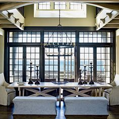 Cross beam table, neutral fabrics and low benches.  Light and Neutral Design | Dining Room | CoastalLiving.com