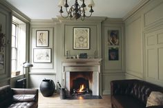 Farrow Ball French Grey Accent Wall Paint Color. Can make walls look like panelling: add trim squaring, paint that is semi gloss. Would be a great library if books on either side of fireplace. Love the comfortable leather couches.