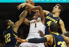 Michigan's Trey Burke, left, and Mitch McGary defend Minnesota's Andre Hollins, who drew a foul last week in Minneapolis.