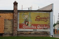 Vintage Squirt soda pop ad / mural. Likely from the 1940's - 1950's   by slworking2 Rockford IL. It was hidden by another building which has been torn down