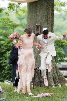 Jumping the broom. {Photo: Rodney Bailey}