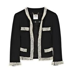 originally created in 1925, a lovely cardigan jacket like the Chanel staple piece wouldn't go wrong.