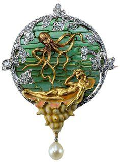 This Louis Aucoc brooch, Paris, 1898 to 1900, uses gold, diamonds, rubies, pearls, and plique à jour enamel.