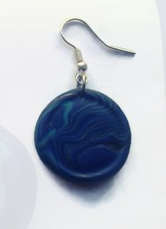 Like a drop of the ocean. Blue and turquoise wave earrings.  www.facebook.com/thequirkycrafthouse