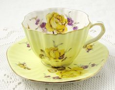 Foley tea cup and saucer, yellow with large yellow roses. Tea cup is white on the inside with more of the floral pattern. Gold trimming on edges of cup and saucer. Markings read: Foley Bone China Made in England Tea Cup Set, My Cup Of Tea, Tea Cup Saucer, Yellow Tea Cups, Teapots And Cups, China Tea Cups, High Tea, Afternoon Tea, Tea Time