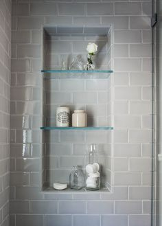 Gray subway tile in shower with matching grout, shower cubbies with glass shelves | Niche Interiors