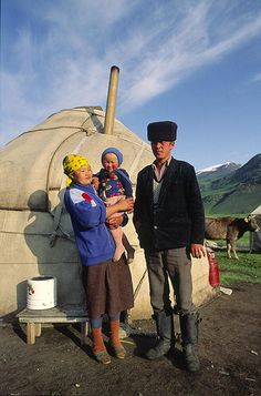 Indigenous People: Kyrgyzstan - A Kirghiz family in front of their yurt in the Tchonkymyn Valley in the Tien Shan Mountains.