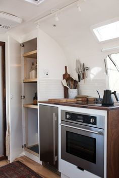 modern caravan airstream remodel kitchen storage