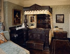 love wallpaper.  Gawthorpe Hall, view of the Huntroyde room showing the carved oak Tester bed C1650