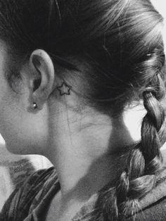 Behind the ear star tattoo