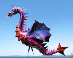 Deep Purple Dragon flamingo  - handmade, garden art sculpture created from a recycled plastic flamingo. via Etsy