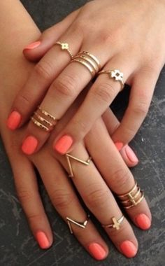 Gold rings + coral nails
