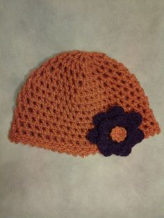 Crocheted Hat with flower by StitchesforSMA on Etsy, $6.00