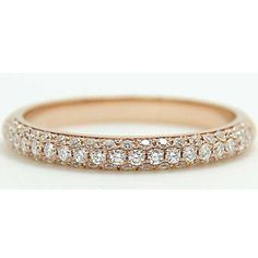 This 2.3mm rose gold half domed #wedding band is decorated with 61 small diamonds in a micro pave setting, stones are closely set to create a continuous sparkling effect as light hits many facets of the band.