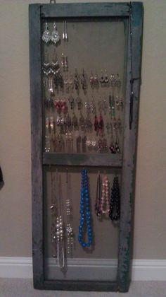 Re-purposed old screen door for hanging jewelry
