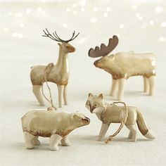 Beautifully glazed Christmas tree ornaments cloak woodland animals in a glossy coat of uniquely varied taupes and browns, leaving their legs unglazed for visual and textural contrast
