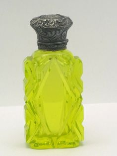 Chartreuse vaseline glass perfume bottle.  from http://berryvogue.com/dinnerware