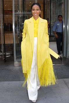 New Trending Celebrity Looks: Jada Pinkett Smith Unveils a New Hybrid Coat in New York. Well this is certainly bold and bright, Miss Jada! You always did know how to —   Whut.        Lady, you can wear a trenchcoat or you can wear a poncho, but you can't wear this … this … PONCHCOAT. No. That is a thing up with which you should not put. It...