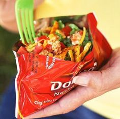 Tacos in a bag. Crunch up Doritos, add in ground beef, salsa, sour cream, cheese and veggies.    Easy cleanup, big on taste!