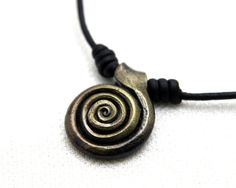Spiral Necklace, an adjustable necklace with a hand forged iron pendant