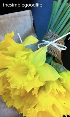 I will lay this simple daffodil bouquet in my lover's lap...since he and daffodils are what I love!