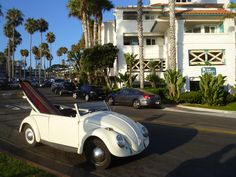 Only in California will you find a vintage VW with a surfboard hanging out the back.  San Clemente Pier