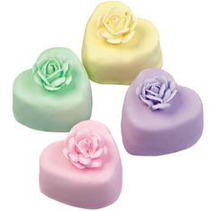 Love's in Bloom Mini Cake - Petite heart cakes are only 1-1/2 in. across! Their tiny size suits thedelicate pastel shades used for the royal icing roses and poured-over,thinned royal icing coating.