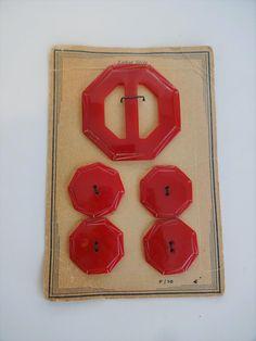 Art Deco Red Bakelite Buckle Button Set Vintage 1940s Original Card  $28  https://www.rubylane.com/item/676693-CL17-143/Art-Deco-Red-Bakelite-Buckle-Button?search=1