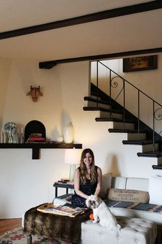 Name: Maria Korovilas, Fashion Designer Location: Silver Lake – Los Angeles, California Size: 1100 square feet Years lived in: Almost 1 year Maria had to move out of her dream apartment in Silver Lake in a short time frame. Luckily, she found a new place a few blocks away (her current home). She was blown away by the architecture, staircase, and the apartment's overall potential. However, the place needed a lot of TLC and a lot of paint! She painted the ceiling beams and the treads on the…