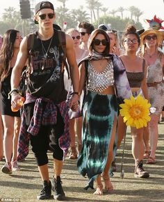 That's quite an outfit! Vanessa Hudgens slips on a pair of over ...