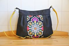 Zinnia Cross Body Bag in AfterGlow in Black with Black Denim Top Band, Zinnias, Black Denim, Black Backgrounds, Black Cotton, Vegan Leather, Printing On Fabric, Diaper Bag, Crossbody Bag