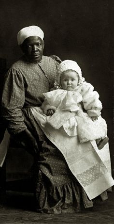 African-American nurse and child. (1900 to 1915)