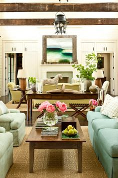 Southern Living - living rooms - Sherwin Williams - Moderate White - long living room, 2 sitting areas, turquoise sofa, turquoise blue sofa,...