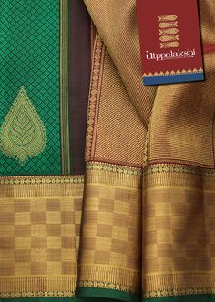 Teal green brocade saree with a brown zari. Silvery leaf motifs are scattered on the body. Grand border with paai weave pattern and an opulent pallu.#Utppalakshi #Silksaree#Kancheevaramsilksaree#Kanchipuramsilks #Ethinc#Indian #traditional #dress#wedding #silk #saree #weaving#Chennai #boutique #vibrant#exquisit#weddingsaree#sareedesign #colorful #vivid #indian #southindian #bridal #festival #sophistication  https://www.facebook.com/Utppalakshi/ Contact: 097899 37149