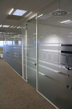 The glass walls on every floor continued the square manifestation from floors 6 and with the room numbers for the meeting suites highlighted in blue. Glass Partition Designs, Glass Office Partitions, Glass Partition Wall, Office Cabin Design, Office Interior Design, Office Interiors, Glass Film Design, Frosted Glass Design, Glass Cabin
