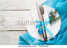 Christmas table setting with christmas decorations white table. Top view, copyspace.