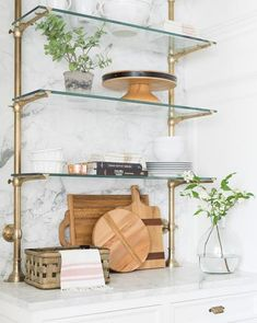 Use wallpaper to upgrade shelving. Assemble-yourself bookcases are an economical choice, but they tend to be boring and look a bit cheap. To make them more stylish, try adding a bold wallpaper on the back of each shelf. Glass Shelves Kitchen, Kitchen Storage, Wine Storage, Kitchen Organization, Organization Ideas, Wood Pieces, New Kitchen, Kitchen Design, Kitchen Interior