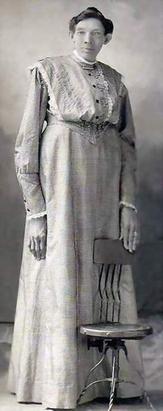 Ella Ewing - Missouri Giantess, reportedly stood 8 feet 4 1/2 inches tall. c. 1902