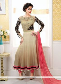 Luxurious beige chiffon designer anarkali suit featuring fancy thread and resham embroidered bold foliage patterns on the yoke part extended till waistline. Contrasting and shimmer wide hemline patch ...