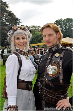 Two Steampunk wanderers, perhaps a female aviator, and a man with a crystal heart?
