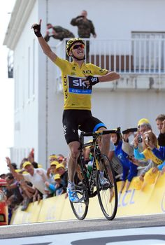 Chris Froome of Sky Pro Cycling Team celebrates winning on Mont Ventoux