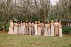 bridesmaids - Each of Kristin's 14 bridesmaids chose their own dress in muted shades. The end result, when all the ladies are adorably lined up, is just the prettiest!