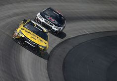 Kevin Harvick Photos Photos - Carl Edwards, driver of the #19 Stanley Toyota, leads Kevin Harvick, driver of the #4 Jimmy John's Chevrolet, during the NASCAR Sprint Cup Series AAA 400 Drive for Autism at Dover International Speedway on May 15, 2016 in Dover, Delaware. - NASCAR Sprint Cup Series AAA 400 Drive for Autism